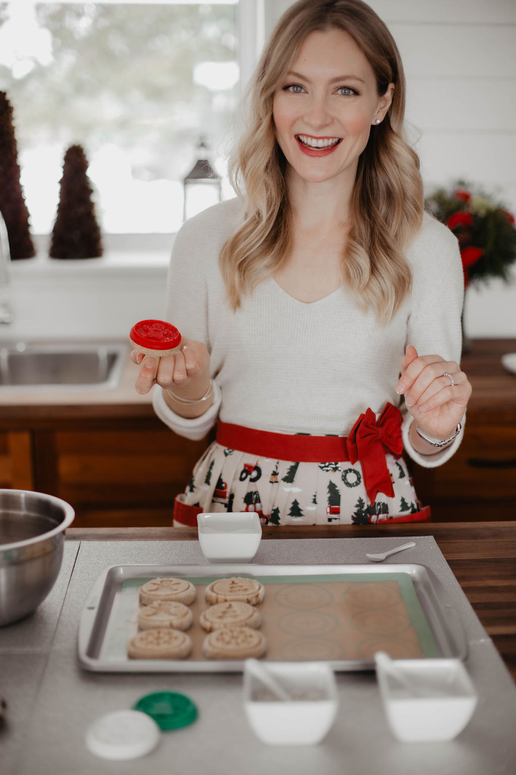 Baking Christmas Cookies Using A Cookie Stamp